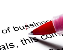 Image of red pen making corrections